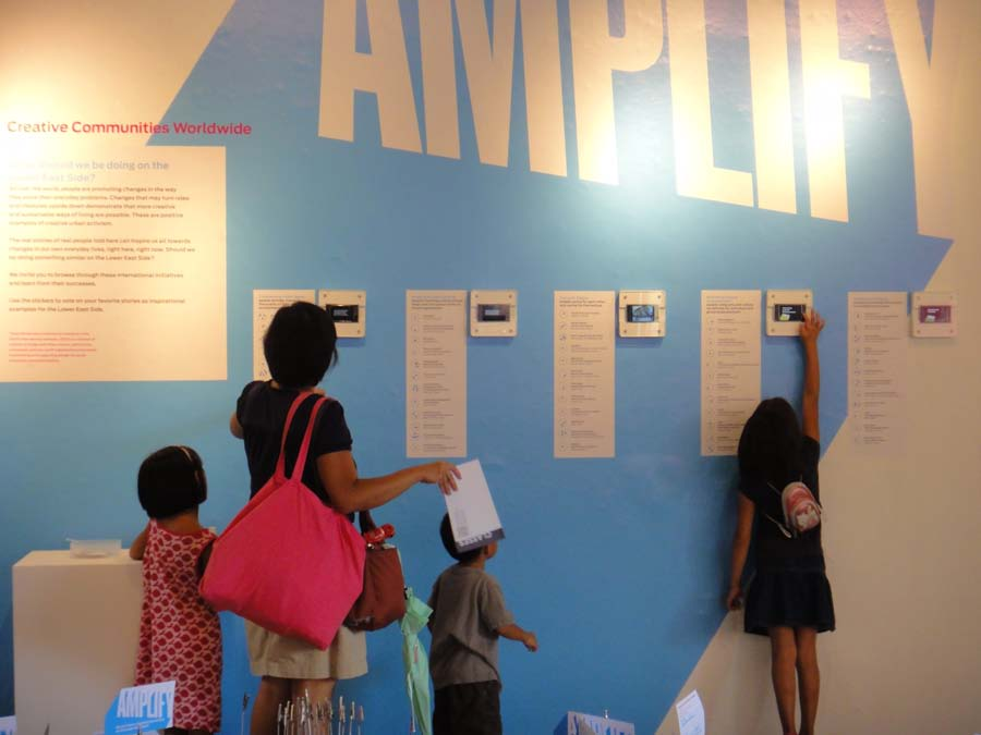 Figure 5: Overview of Section 3 of the Amplify exhibition at the Abrons Art Center with wallmounted iPods.